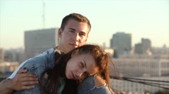 Young loving couple romantic date on the roof above the city 4K Stock Footage