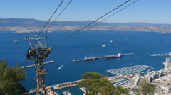 The Gibraltar cable car descending past the city Stock Footage
