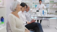 4K Friendly pharmacy worker gives prescription medication to customer Stock Footage