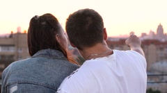 Young loving couple romantic date on the roof above the city Stock Footage