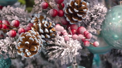 Snow-Dusted Fir Branch With Christmas Toys, Cones Stock Footage
