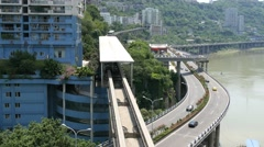 Chongqing monorail with highways Stock Footage