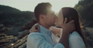 Beautiful couple kisses and enjoys of sun ,beautiful laughing each other Stock Footage