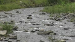 River Flows Over Rocks Just Above the Ground Nature Footage Stock Footage