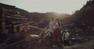 Happy couple having fun outdoors beside woods Stock Footage