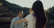 Woman running in the arms of her boyfriend man Stock Footage