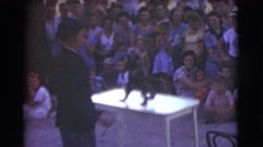 1951: small monkey performing for crowd CANADA Stock Footage