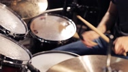 Male musician playing drums and cymbals at concert Stock Footage