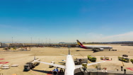 Zoom Pan Timelapse Ground Crew Loading Servicing Parked Airplane Airport Gate Stock Footage
