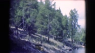 1951: shot of mountain forest next to a lake. CANADA Stock Footage