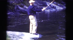 1951: a man on the shore of a beautiful lake fishing CANADA Stock Footage