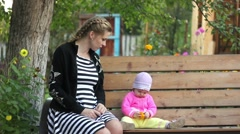 Mother with a child on the bench Stock Footage