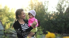 Mother with child in garden of flowers Stock Footage