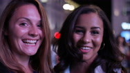 Two female friends making a video call at night in the city Stock Footage