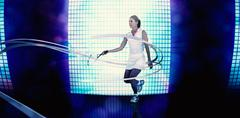 Athlete playing tennis with a racket  against background of blue squares Stock Photos