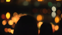Woman Shooting water lanterns using a mobile phone Stock Footage