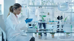 4K Research scientists studying plant life in laboratory Stock Footage