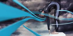 Swimmer in wetsuit preparing to dive against gloomy sky Stock Photos