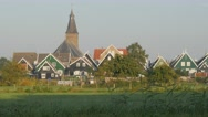Traditional houses with church,Marken,Netherlands Stock Footage