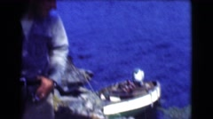 1951: blue water-body with banks rich in trees seen from a moving boat CANADA Stock Footage