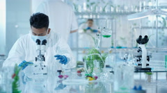 4K Portrait smiling Asian research scientist working in laboratory Stock Footage