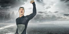 Swimmer posing after victory against country scene Stock Photos