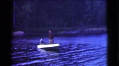 1951: two men going out on the lake in a boat ready to catch some big fish  Stock Footage