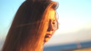 Girl on the beach. at sunset with her hair in the wind Stock Footage