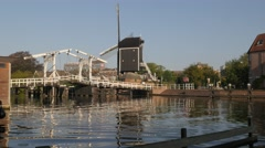Historical drawbridge and windmill along canal,Leiden,Netherlands Stock Footage