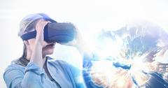 Earth seen from space against woman using a virtual reality device Kuvituskuvat