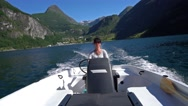 Woman driving a motor boat Stock Footage