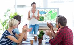 Composite image of colleagues clapping hands in a meeting Stock Photos