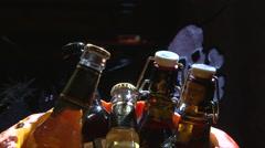 Halloween pumpkin jack o lantern with bottle beer Stock Footage