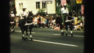 1968: people on horses trotting through the city street in a parade VANCOUVER, Stock Footage