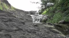 Waterfall on The Black Rocks Stock Footage