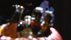 Soft focus Halloween pumpkin with bottle beer inside filling with ice cubes Stock Footage
