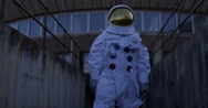 4K Astronaut on an exploration trip, walking away from mission control building. Stock Footage