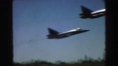 1968: individuals get out of vehicle to watch airplanes flying ahead VANCOUVER, Stock Footage