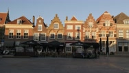 Step houses on square with restaurant,Dordrecht,Netherlands Stock Footage