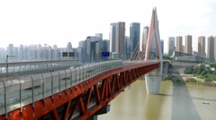 China Chongqing Qianximen twin river bridge side perspective to city blocks Stock Footage