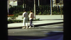 1968: two peoples are walking carefully when cross the pedestrians VANCOUVER, Stock Footage