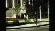 1968: two people are watching a white house in front of him VANCOUVER, CANADA Stock Footage