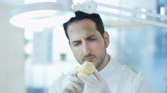 4K Food science researcher working in laboratory examining a corn cob Stock Footage
