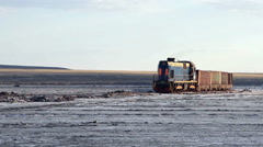Old rusty train on the salt lake Baskunchak Stock Footage