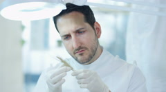 4K Scientific researcher in laboratory analyzing plant sample Stock Footage