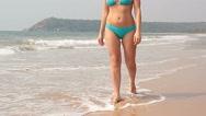 Woman walking on sand beach leaving footprints Stock Footage