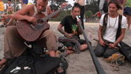 Unidentified man playing music on the beach. Stock Footage