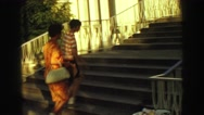 1968: a couple walking up the stairs towards a large platform VANCOUVER, CANADA Stock Footage