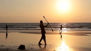 Man spinning pole on the beach. Stock Footage
