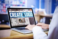Webpage for create a logo against businessman using a laptop Stock Photos